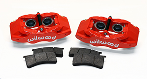 Wilwood SLC56 Front Replacement Caliper Kit Parts Laid Out - Red Powder Coat Caliper