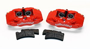 Wilwood DPC56 Rear Replacement Caliper Kit Parts Laid Out - Red Powder Coat Caliper